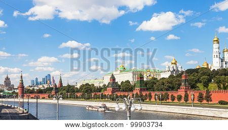 Moscow skyline - view of Kremlin embankment from Moskva River in sunny summer day poster