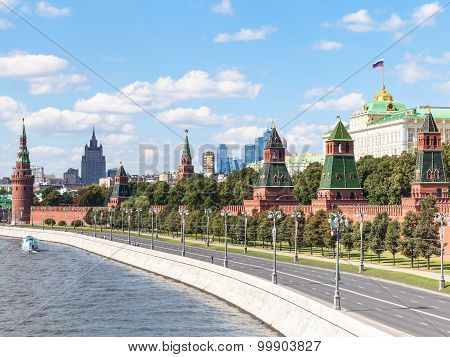 Moscow cityscape - view of Red Walls and Towers of Moscow Kremlin on Kremlin Embankment of Moskva Rive in Moscow Russia in summer day poster
