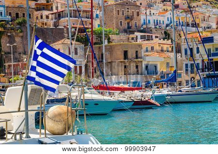 Blue white Greek flag on wind in Greece port, Kos