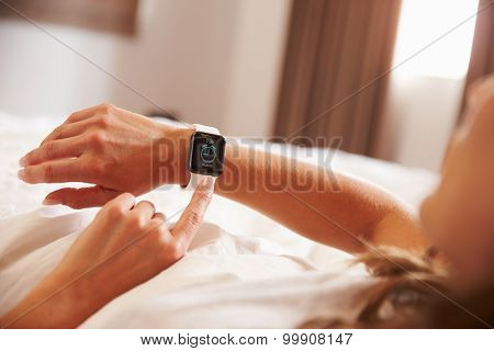 Woman Lying in Bed Woken Up by Alarm Clock App on Smart Watch