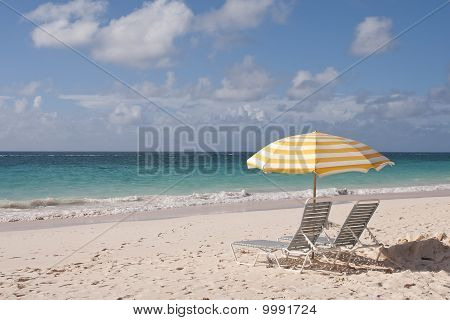Lounge Chairs and Umbrella On Beach