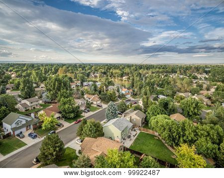 FORT COLLINS, CO, USA - AUGUST 27, 2015: Aerial view of Fort Collins at late summer, a typical residential street along Front Range of Rocky Mountains in Colorado with 30 years old houses