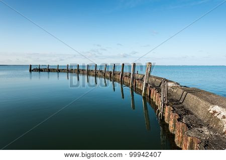 Old Breakwater On A Windless Day