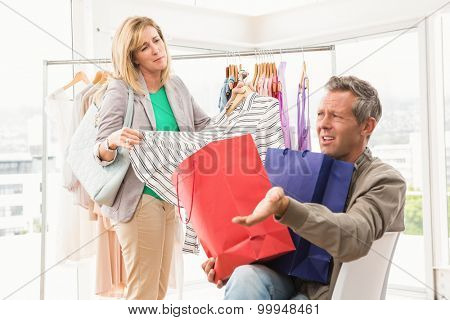 Man complaining about his shopping woman in clothing store