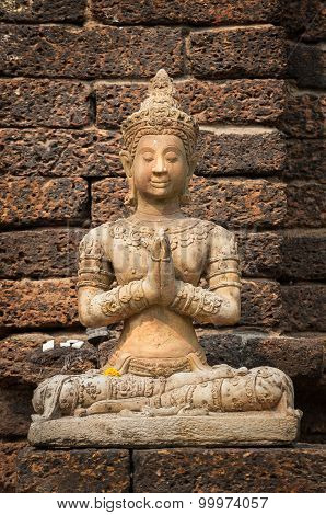 Stone Buddha Statue Seated In Prayer Pose At Wat Jet Yod, Chiang Mai, Thailand