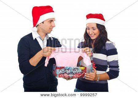 Young Couple Receiving Surprising News At Christmas