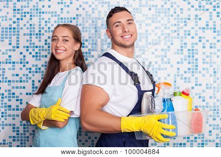 Cheerful washers are doing clean-up in bathroom