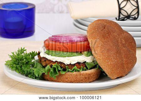 Vegetarian Black Bean Burger On A Whole Wheat Roll.