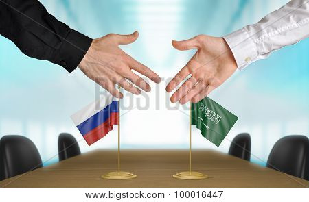 Russia and Saudi Arabia diplomats agreeing on a deal