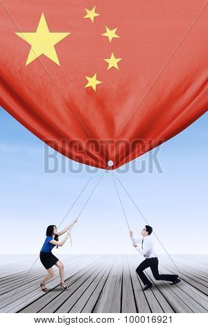Entrepreneurs Pulling Down A Chinese Flag