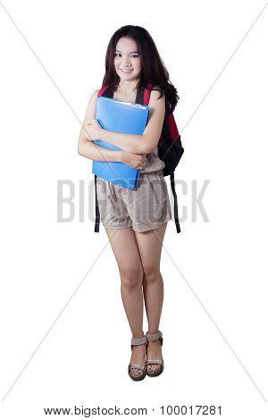 Female Teenage Student Standing In The Studio