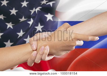 Helping Hands With American And Russian Flags