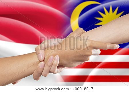 Helping Hands With Indonesian And Malaysian Flags