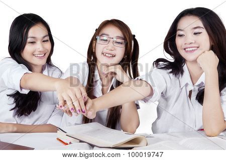 Students Showing Unity With Their Hands
