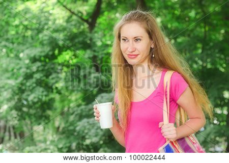 Girl Is Holding Drink In The Park