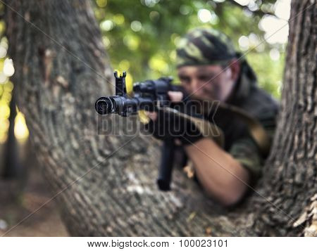 Soldier Shooting From A Kalashnikov Closeup
