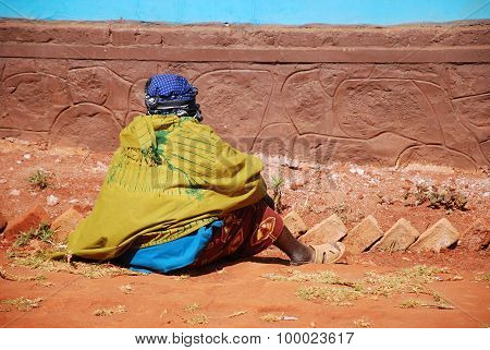 A Woman Sitting Waiting For His Turn To Be Visited