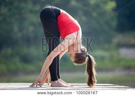 Teenage Girl Doing Standing Forward Bend Pose