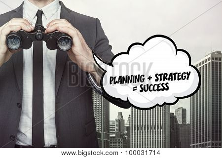 Planning text on speech bubble with businessman holding binoculars