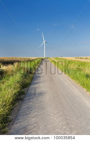 Road Leading To Wind Turbine