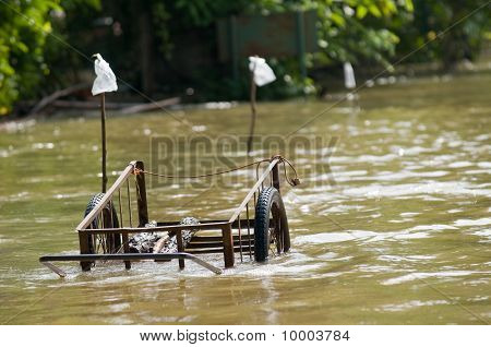 Handcart Left At A Flooded Road