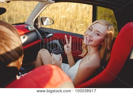 Pretty girlfriend and boyfriend are traveling by transport