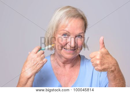 Happy Woman With Injection Showing Thumbs Up