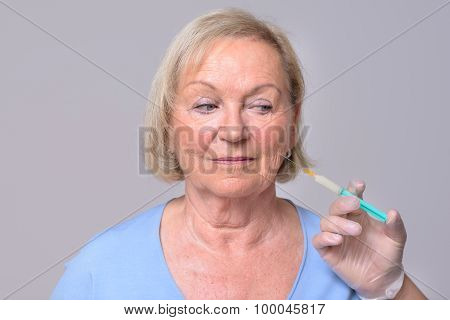 Injection On The Face Of Middle Aged Woman