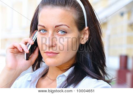 Beautiful Smiling Woman Is Talking Phone At Sunny Street