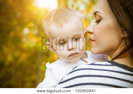 Mother With Her Baby Daughter In Autumn Park
