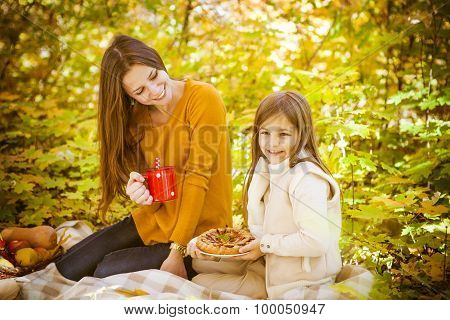 Two Cheerful Sisters In The Park In Warm Autumn Day