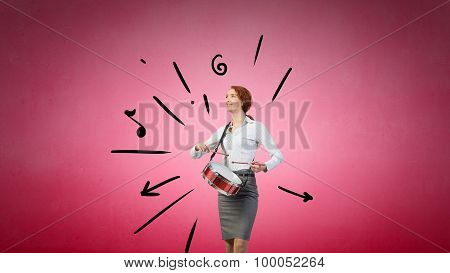 Businesswoman playing drums