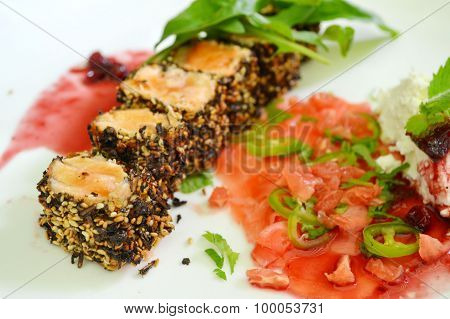 Tasty sushi rolls made of roasted salmon and sesame