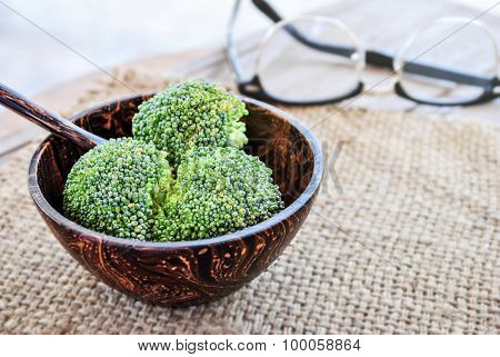Fresh Broccoli In Wooden Bowl On Pattern Bamboo For Background