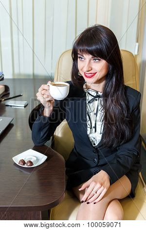 Attractive Woman Drinking Coffee In The Office