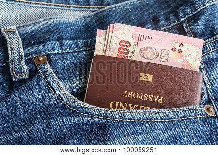 Thailand Passport And Thai Money Banknote In Denim Jean's Pocket