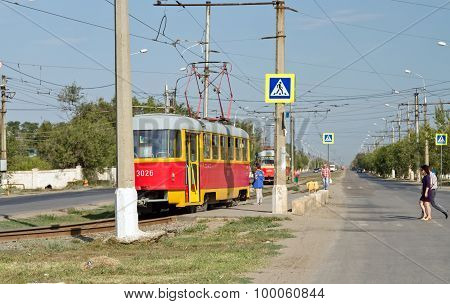 Passengers In A Hurry To Take Their Seats In The Tram