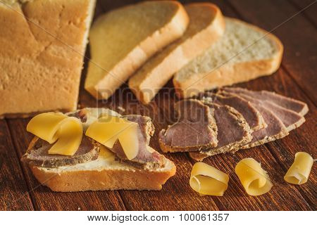 Bread With Butter And Slices Of Veal And Cheese