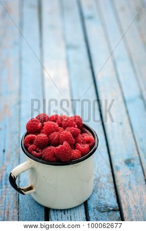 White Can And Mug With Fresh Raspberry