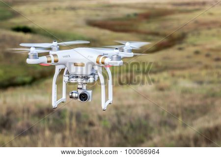 FORT COLLINS, CO, USA, AUGUST 28, 2015:  Airborne radio controlled Phantom 3 quadcopter drone flying with a camera over prairie.