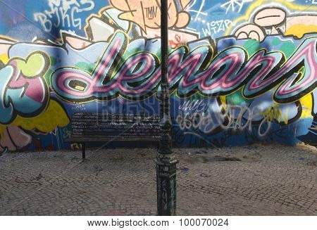 A Bench And A Light Pole In Calcada Do Lavra Street In Lisbon