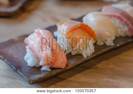 Sushi On The Black Dish