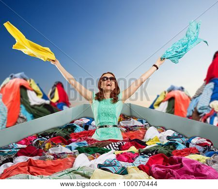 Happy woman sitting in clothes