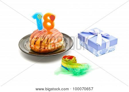 Donut With Eighteen Years Birthday Candle, Whistle And Gift On White