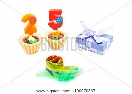 Cakes With Twenty Five Years Birthday Candles, Whistle And Gift On White