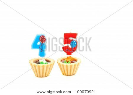 Cakes With Forty Five Years Birthday Candles On White