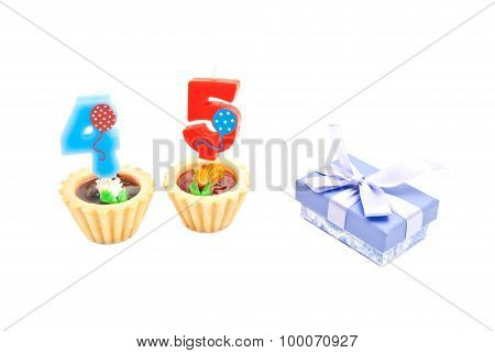 Cakes With Forty Five Years Birthday Candles And Gift On White