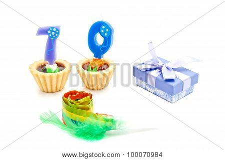 Cakes With Seventy Years Birthday Candles, Whistle And Gift On White