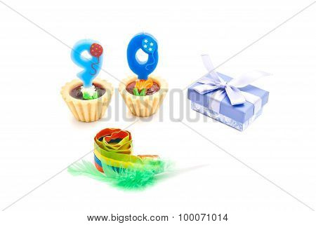 Cakes With Ninety Years Birthday Candles, Whistle And Gift On White