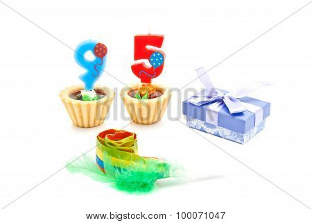 Cakes With Ninety Five Years Birthday Candles, Whistle And Gift On White